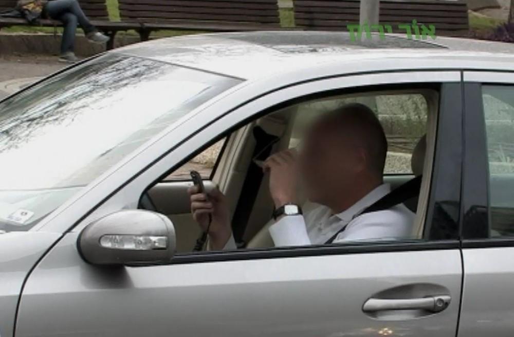 נהגים מדברים בטלפון (צילום: אור ירוק)