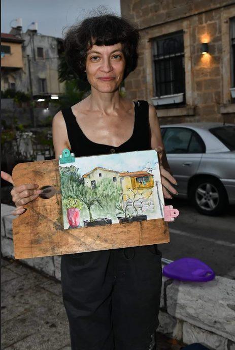 אומנות רחוב חיה במושבה הגרמנית בחיפה (צילום: ארתור מינצר)