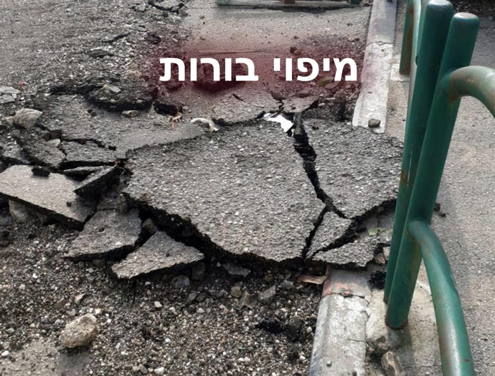 מיפוי בורות בחיפה - בור בכביש ברחוב סליזיאן פינת יפו 91 בחיפה (צילום: עאמר עודה)