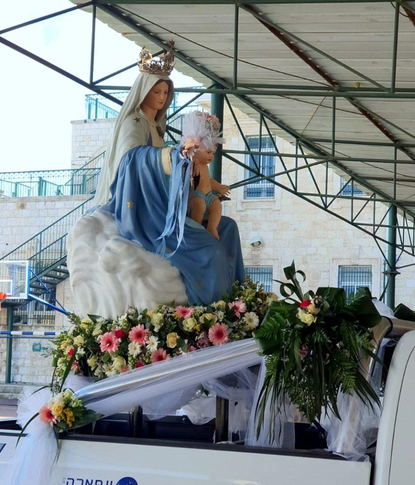 תהלוכת מריה הקדושה 101 (מאהידה כרכבי עבוד - מרכז הפרחים)