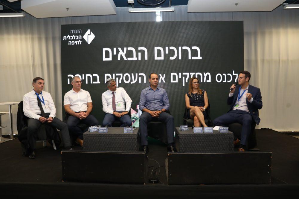 יושבי הפאנל בכנס הכלכלי בחיפה (צילום: מיכה בריקמן)