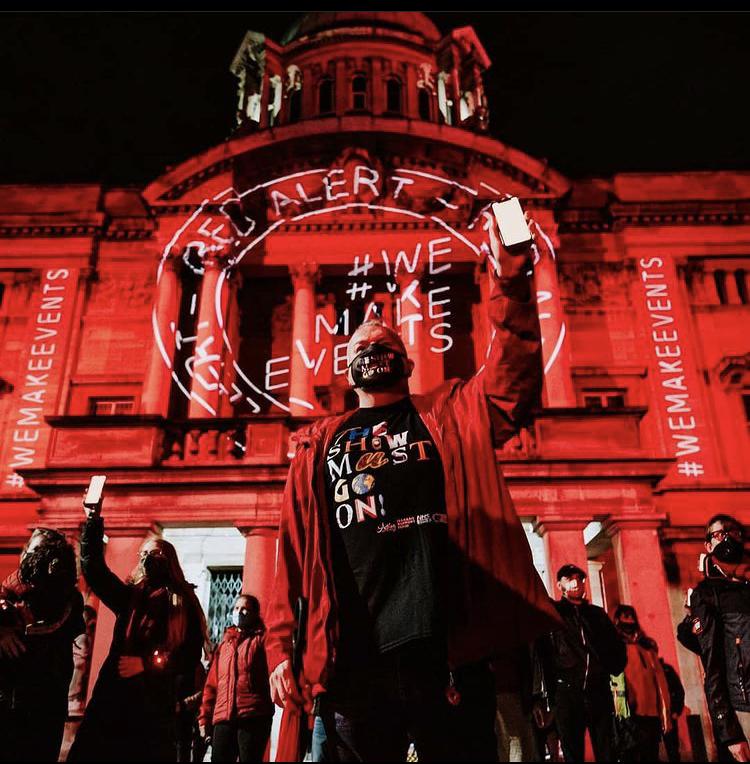 מחאה אדומה בחיפה (צילום: TOM ARRAN אנגליה, איטליה, ניו יורק - BOB CAREY)