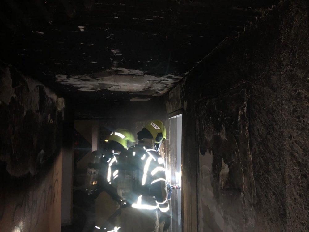 שריפה בבניין מגורים בקריית אתא (צילום: כבאות והצלה)