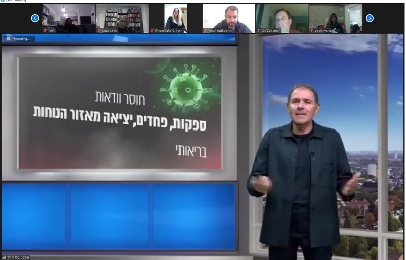 אלי גוטמן בהרצאה (צילום: החברה הכלכלית לחיפה)