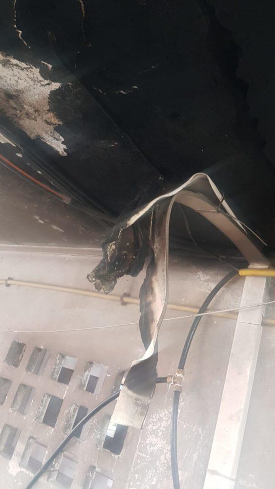 שריפה ודליפה גז במבנה ברחוב הרצל בחיפה (צילום: כבאות והצלה)
