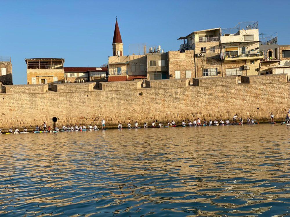 """הזינוק תחת חומות עכו -  אירוע """"חותרי המפרץ"""" (צילום: שלמה מומו כהן)"""