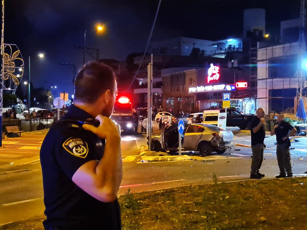 זירת פיצוץ רכב בעוספיה (צילום: משטרת ישראל)